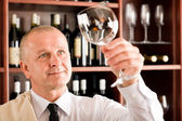 Wine bar waiter clean glass looking at — Stock Photo