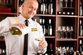Waiter serve wine glass happy restaurant — Foto de Stock