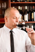 Bar waiter taste glass red wine restaurant — Photo