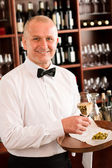 Wine bar waiter mature serve glass restaurant — Foto de Stock