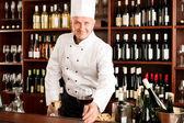 Chef cook smiling serve wine glass restaurant — Stock Photo