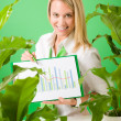 Green business office woman show charts plants — Stock Photo #8600286