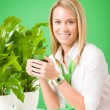 Green business woman in office smiling coffee — Stock Photo #8600297