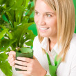 Green business office woman smiling plants - ストック写真