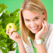 Stock Photo: Green business office woman smiling hold apple