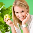 Green business office woman smiling hold apple — Stock Photo #8600355