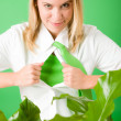 Superhero Businesswoman confident face green plant - Stock Photo