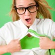 Green Superhero Businesswoman crazy face - Stock Photo