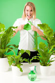 Green business superhero woman crazy plants — Stock Photo
