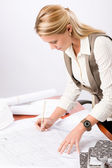 Architect woman sketches office with blueprint — Stock Photo