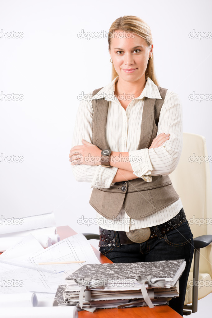 Attractive young architect woman with sketches behind office desk — Stock Photo #8600605