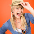 Crazy blond girl wear hat shouting - Stock Photo