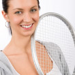 Tennis player woman young smiling hold racket — Stock Photo #8849209