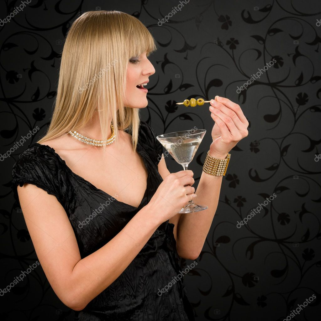 Woman party dress hold cocktail glass eat olives smiling — Stock Photo #8843410
