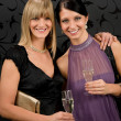 Stock Photo: Womfriends party dress hold champagne glass