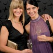 Woman friends party dress hold champagne glass — Stock Photo