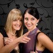 Woman friends party dress point at smiling — Stock Photo