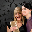Woman friends party dress smiling spying someone — Stock Photo