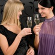 Woman friends party dress toast champagne glass — Stock Photo #8852070