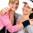 Two sport woman friends hugging smiling — Stock Photo