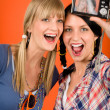 Two young woman friends taking picture smiling — Stock Photo #8852152