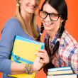 Two woman friends young students hold books — Stockfoto