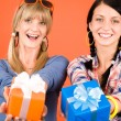 Two young woman friends hold party presents — Stock Photo #8852168
