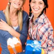 Two young woman friends hold party presents — Stock Photo #8852171