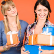 Two young woman friends hold party presents — Stock Photo