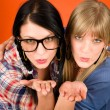 Two woman friends young send kiss — Stock Photo