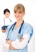 Medical team doctor young nurse female smiling — Stock Photo