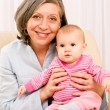 Grandmother hold little baby girl smiling — Stock Photo
