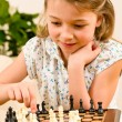 Young girl play chess cute smile - Stock Photo
