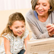 Grandmother teach young girl learn music notes — Stock Photo #8943271