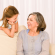Grandmother and granddaughter look at each other — Stock Photo