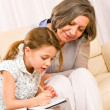 Grandmother help granddaughter doing homework — Stock Photo