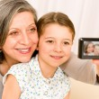 Grandmother and young girl take picture themselves — Stock Photo #8943342