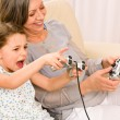 Grandmother and granddaughter play computer game - Stock Photo