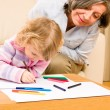Grandmother and granddaughter drawing at home — Stock Photo