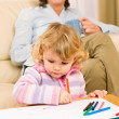 Grandmother and granddaughter drawing at home — Stock Photo #8943489