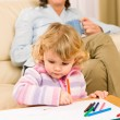 Grandmother and granddaughter drawing at home - Stock Photo