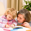 Little girl with grandmother drawing together — Stock Photo #8943509