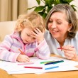Little girl with grandmother drawing together — Stock Photo #8943516