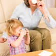 Little girl with grandmother eat cookies — Stock Photo