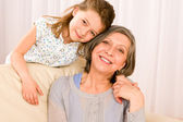 Grandmother with young girl smile relax together — Stock Photo