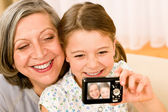 Grandmother and young girl take picture themselves — Stock Photo