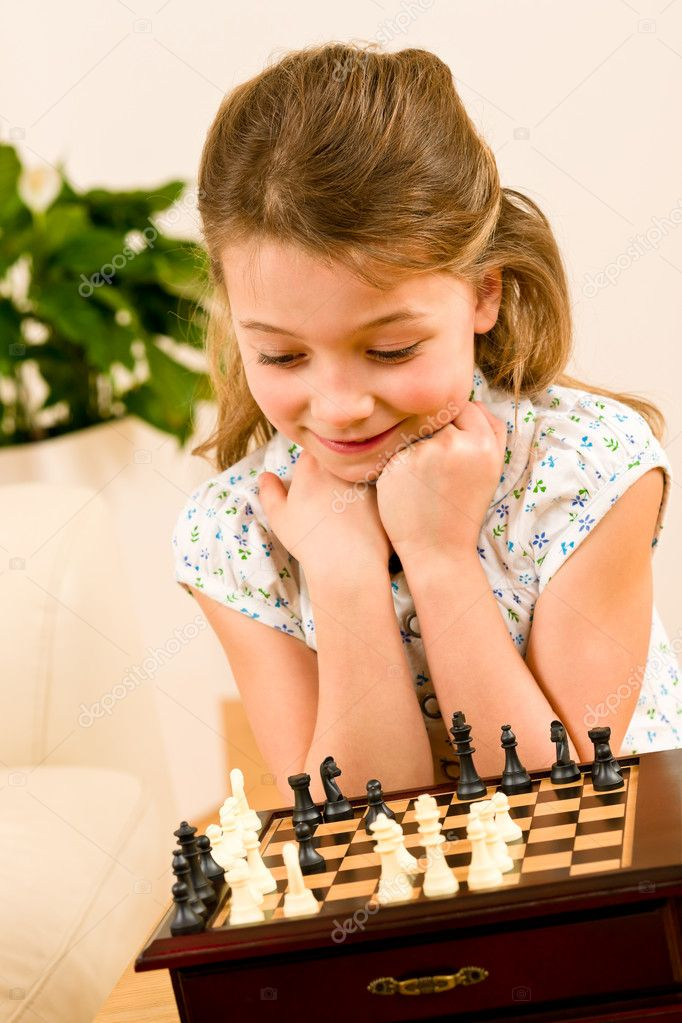 Young girl play chess cute smile alone at home — Stock Photo #8943222
