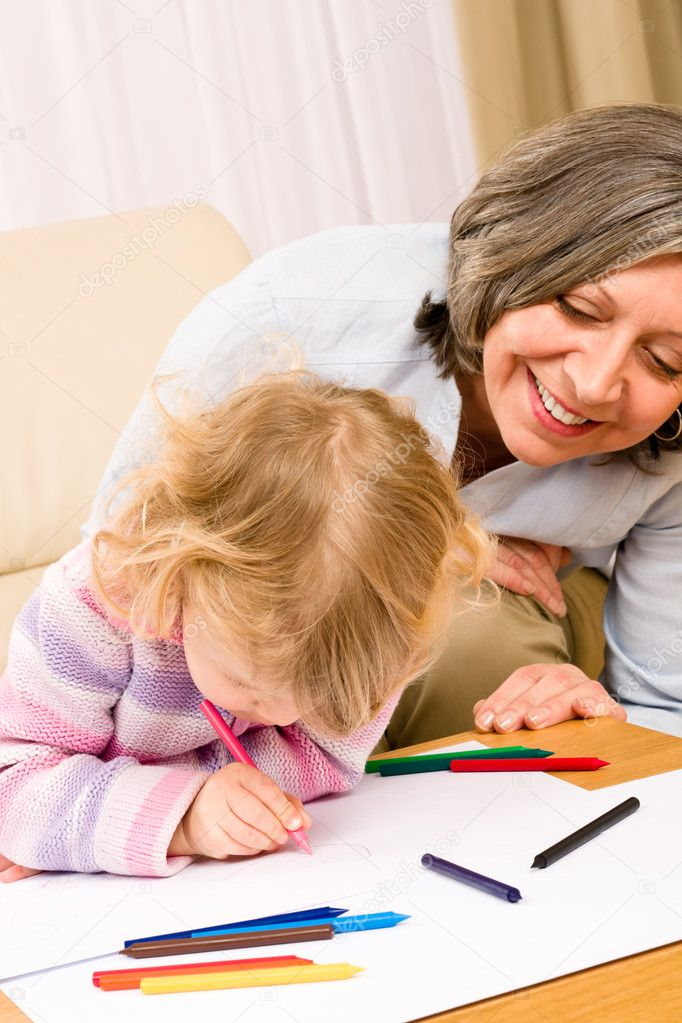 Grandmother and little girl drawing together with pencils at home — Stock Photo #8943484