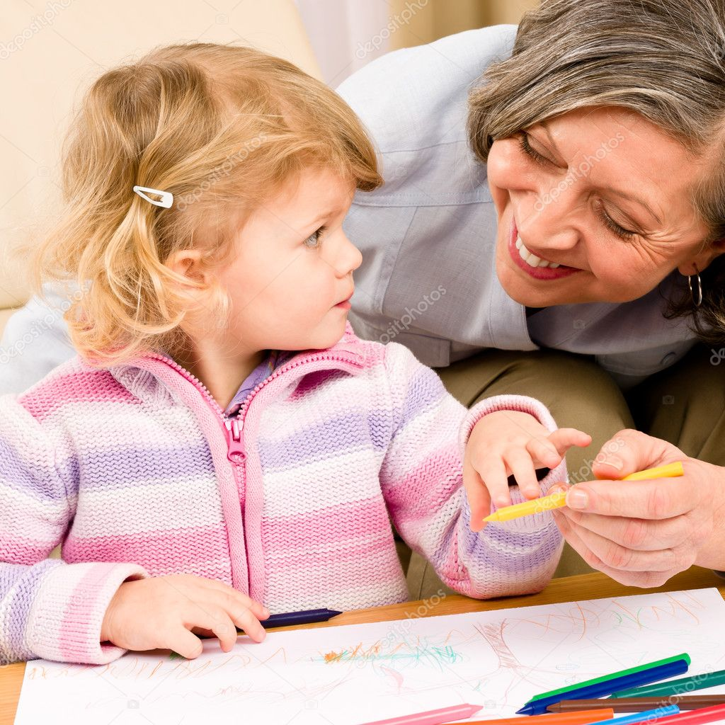Grandmother and granddaughter drawing together with pencils at home — Stock Photo #8943495