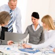 Business-Team-Meeting um den Tisch — Stockfoto #9036672